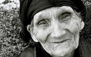 Old woman smiling a little bit