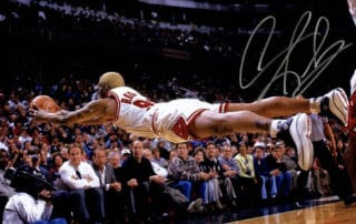 "Denis Rodman ""flying"" to catch a ball"
